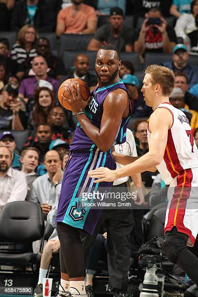 Al Jefferson of the Charlotte Hornets looks for an opening against Justin Hamilton of the Miami Heat during the game at the Time Warner Cable Arena...