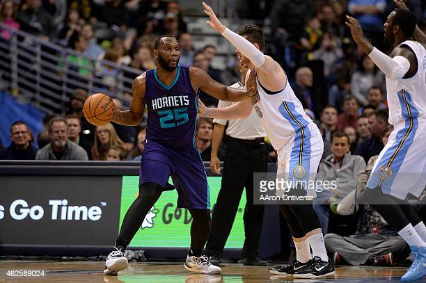 Al Jefferson of the Charlotte Hornets passes around Jusuf Nurkic of the Denver Nuggets during the first quarter of action The Denver Nuggets hosted...