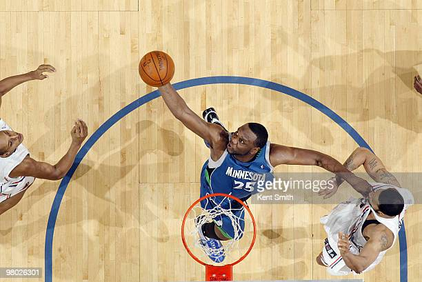 Al Jefferson of the Minnesota Timberwolves dunks against Tyson Chandler of the Charlotte Bobcats on March 24 2010 at the Time Warner Cable Arena in...