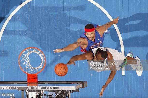 Al Jefferson of the Minnesota Timberwolves goes to the basket under pressure against Rasheed Wallace of the Detroit Pistons during the game on...