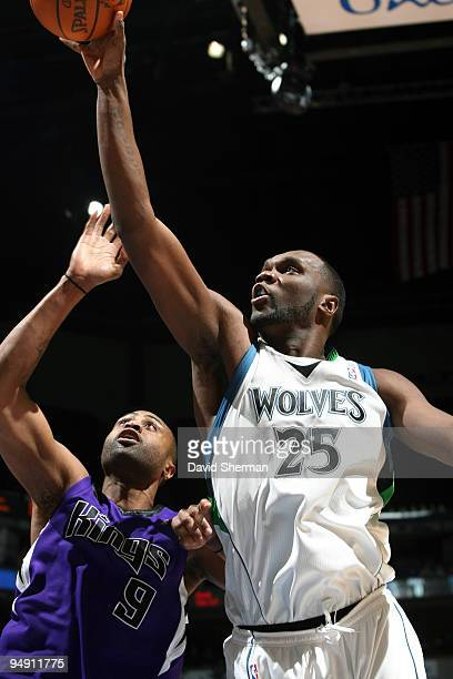 Al Jefferson of the Minnesota Timberwolves shoots over Kenny Thomas of the Sacramento Kings during the game on December 18 2009 at the Target Center...