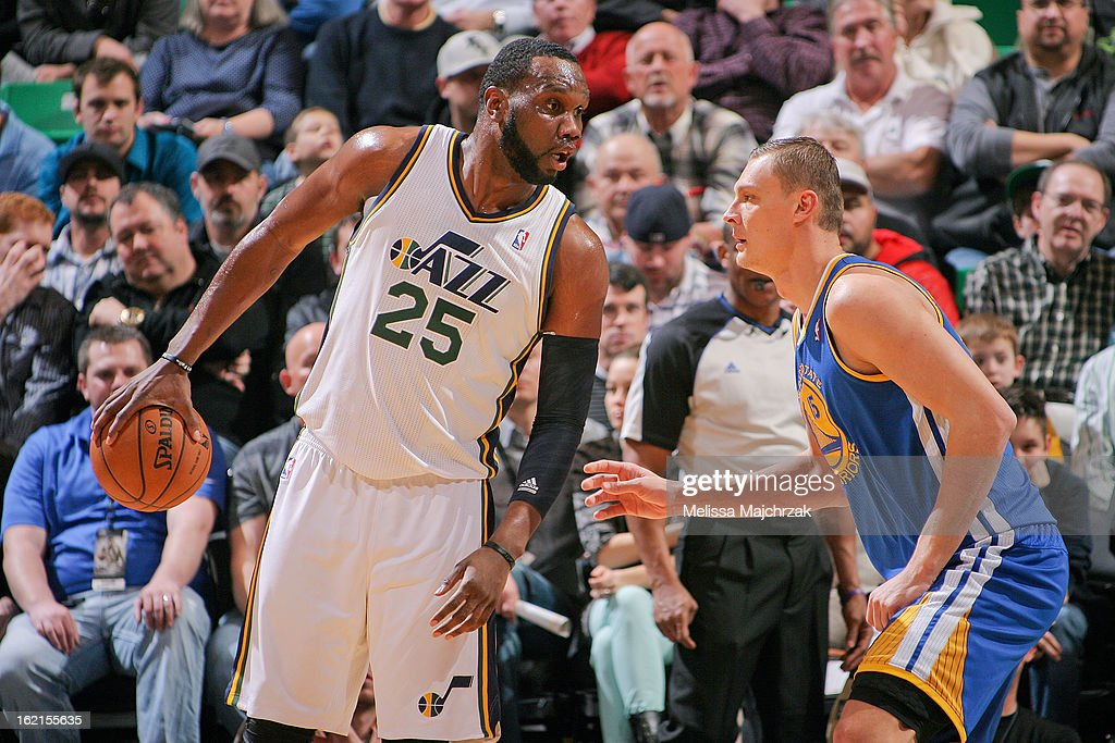 Al Jefferson #25 of the Utah Jazz controls the ball against Andris Biedrins #15 of the Golden State Warriors at Energy Solutions Arena on February 19, 2013 in Salt Lake City, Utah.
