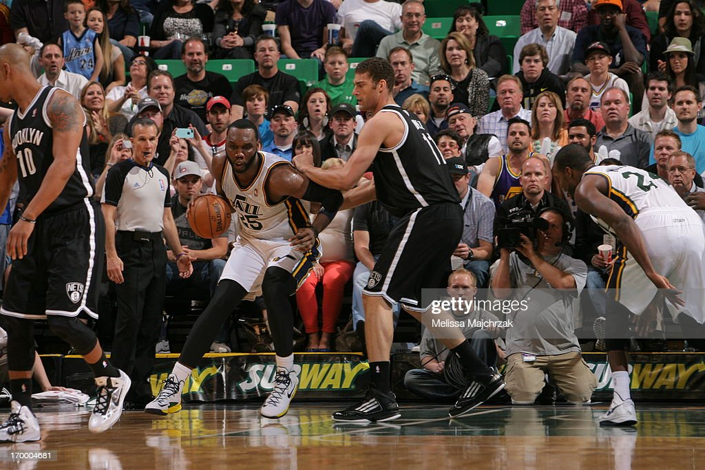 Al Jefferson #25 of the Utah Jazz controls the ball against Brook Lopez #11 of the Brooklyn Nets at Energy Solutions Arena on March 30, 2013 in Salt Lake City, Utah.