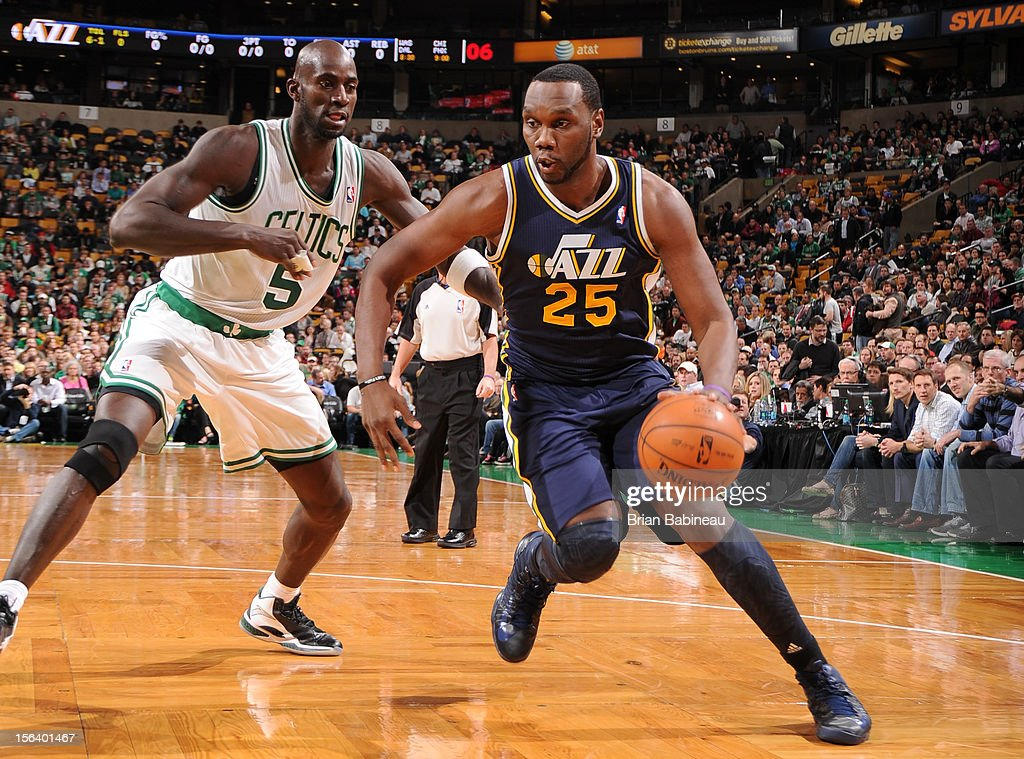 Al Jefferson #25 of the Utah Jazz drives to the hoop vs Kevin Garnett #5 of the Boston Celtics on November 14, 2012 at the TD Garden in Boston, Massachusetts.