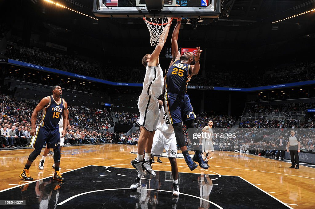 Al Jefferson #25 of the Utah Jazz goes to the basket against Brook Lopez #11 of the Brooklyn Nets during the game at the Barclays Center on December 18, 2012 in Brooklyn, New York.