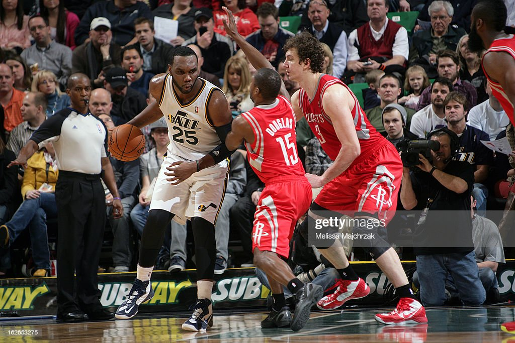 Al Jefferson #25 of the Utah Jazz looks to pass the ball against the Houston Rockets at Energy Solutions Arena on January 28, 2013 in Salt Lake City, Utah.