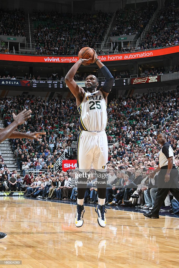 Al Jefferson #25 of the Utah Jazz shoots a jumper against the Miami Heat at Energy Solutions Arena on January 14, 2013 in Salt Lake City, Utah.