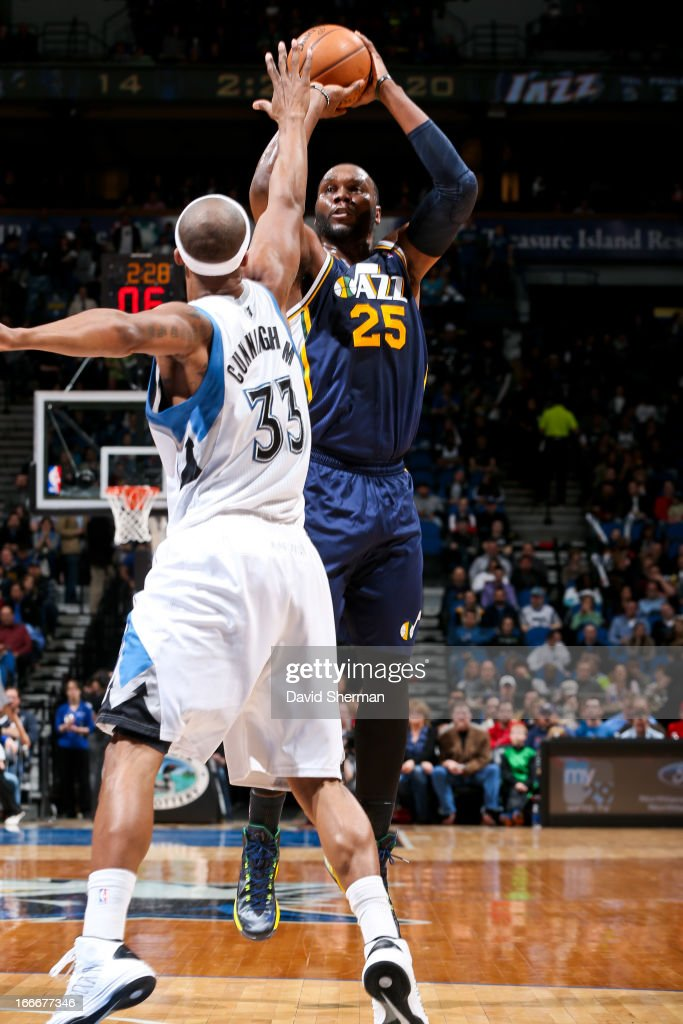 Al Jefferson #25 of the Utah Jazz shoots against Dante Cunningham #33 of the Minnesota Timberwolves on April 15, 2013 at Target Center in Minneapolis, Minnesota.
