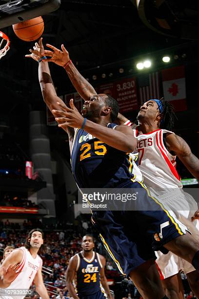 Al Jefferson of the Utah Jazz shoots the ball over Jordan Hill of the Houston Rockets on January 8 2011 at the Toyota Center in Houston Texas NOTE TO...