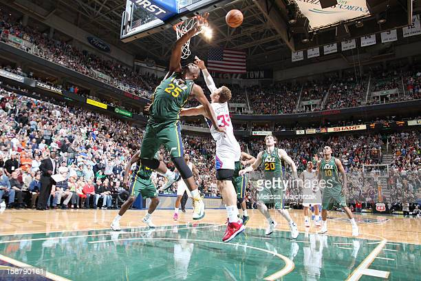 Al Jefferson of the Utah Jazz tips ball to teammate Gordon Hayward after Chris Paul of the Los Angeles Clippers misses his second free throw at...