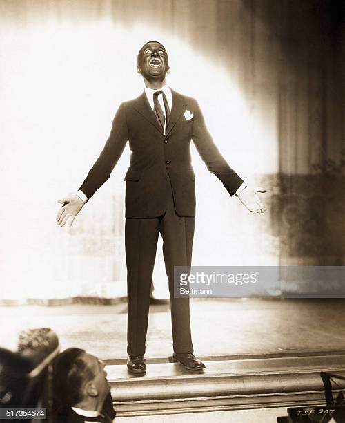 """Al Jolson with blackface performing on stage in """"The Singing Fool."""" Movie still. A Warner Bros. Production"""