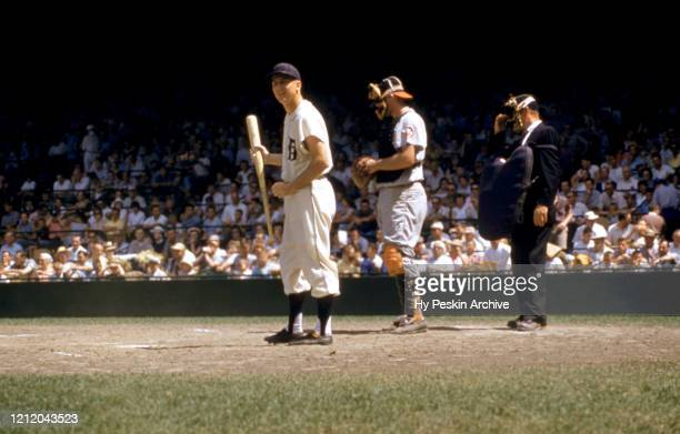 Al Kaline of the Detroit Tigers looks down to his third base coach to get the sign during an MLB game against the Baltimore Orioles on June 28 1959...