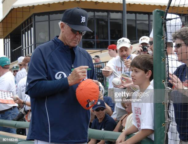Al Kaline of the Detroit Tigers signs an autograph for a fan before the game against the Cleveland Indians at Joker Marchant Stadium in Lakeland...