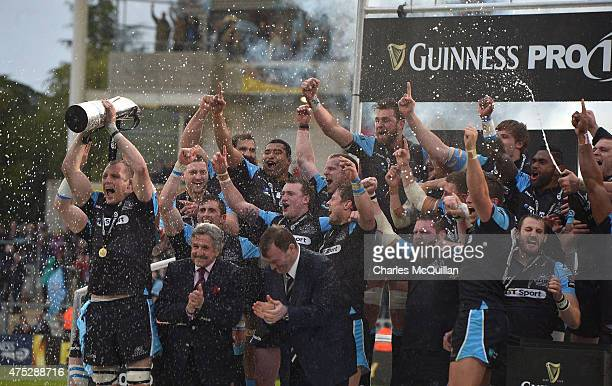 Al Kellock of the Glasgow Warriors lifts the Pro 12 trophy after his team's victory during the Guinness Pro 12 final match between Munster and...