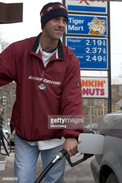 Al LaMarca fills up his car with gasoline at Exxon station on Tuesday January 16 in Boston Massachusetts Crude oil fell to a 19month low in New York...