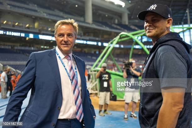 Al Leiter speaks with Aaron Boone of the New York Yankees before the game against the Miami Marlins at Marlins Park on August 21 2018 in Miami Florida