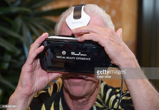 Al Lindahl takes a 3D engine journey with the Oculus Riftpowered Gear VR headset at the Penske Wynn Ferrari Showroom at Wynn Las Vegas at the Shell...