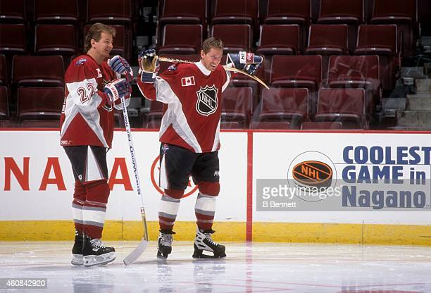 Al MacInnis of the St Louis Blues and Wayne Gretzky of the New York Rangers and both of North Americas skates on the ice during warmups before the...