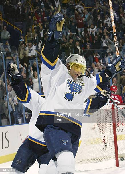 Al MacInnis of the St Louis Blues celebrates the overtime win after teammate Tom Koivisto scored the overtime game winner against the Carolina...