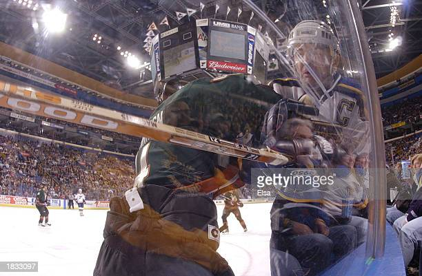 Al MacInnis of the St Louis Blues is hit by Ossi Vaananen of the Phoenix Coyotes in the first period on March 6 2003 at the Savvis Center in St Louis...