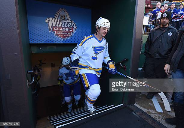 Al MacInnis of the St Louis Blues makes his way to the ice surface in between periods during the 2017 Bridgestone NHL Winter Classic Alumni Game at...