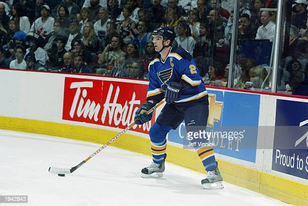 Al MacInnis of the St Louis Blues plays the puck against the Vancouver Canucks during the first round of the 2003 Stanley Cup playoffs at General...