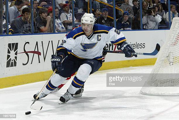 Al MacInnis of the St Louis Blues takes the puck against the Chicago Blackhawks at the Savvis Center on April 3 2003 in St Louis Missouri The...