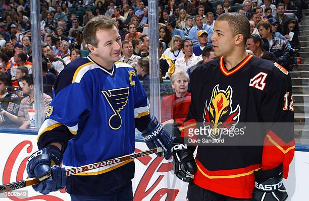 Al MacInnis of the St Louis Blues talks with Jarome Iginla of the Calgary Flames as they compete during the NHL AllStar SuperSkills competition at...