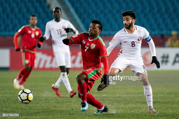 Al Mandhar Al Alawi of Oman and Ahmad Moein of Qatar compete for the ball during the AFC U23 Championship Group A match between Oman and Qatar at...