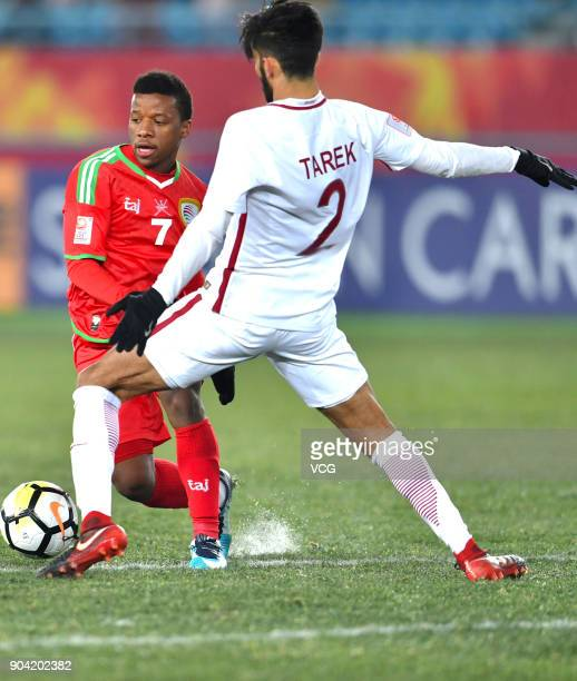 Al Mandhar Al Alawi of Oman and Tarek Salman of Qatar compete for the ball during the AFC U23 Championship Group A match between Oman and Qatar at...