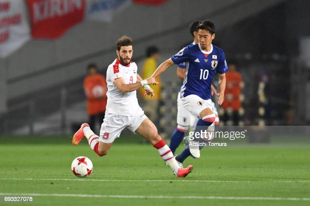 Al Mawas Mahmoud of Syria runs with the ball during the international friendly match between Japan and Syria at Tokyo Stadium on June 7 2017 in Chofu...