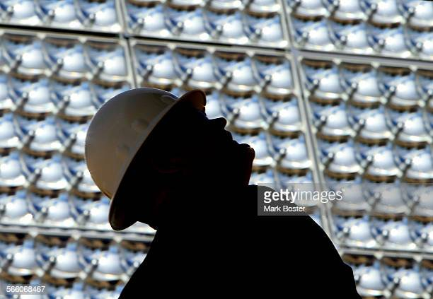 Al McQuilkin, Senior Construction Manager with gkkworks looks over the solar arrays at the newly constructed Solar Micro Generating Facility at...