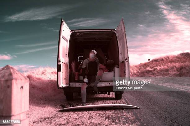 Al Mennie pauses as he sits in the back of his van on October 27 2017 in Portrush Northern Ireland Due to Mennie's height at 6'5 and complexion he is...