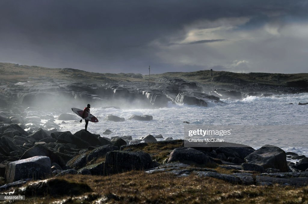 Al Mennie stares across a bay containing strengthening offshore winds and a riptide as he decides on which line to access the water on February 7, 2017 in Donegal, Ireland. Choosing an entry and exit spot on stormy days can be fraught with danger. Faced with the prospect of contesting heavy white water turbulence, a razor sharp outcrop only complicates matters further.