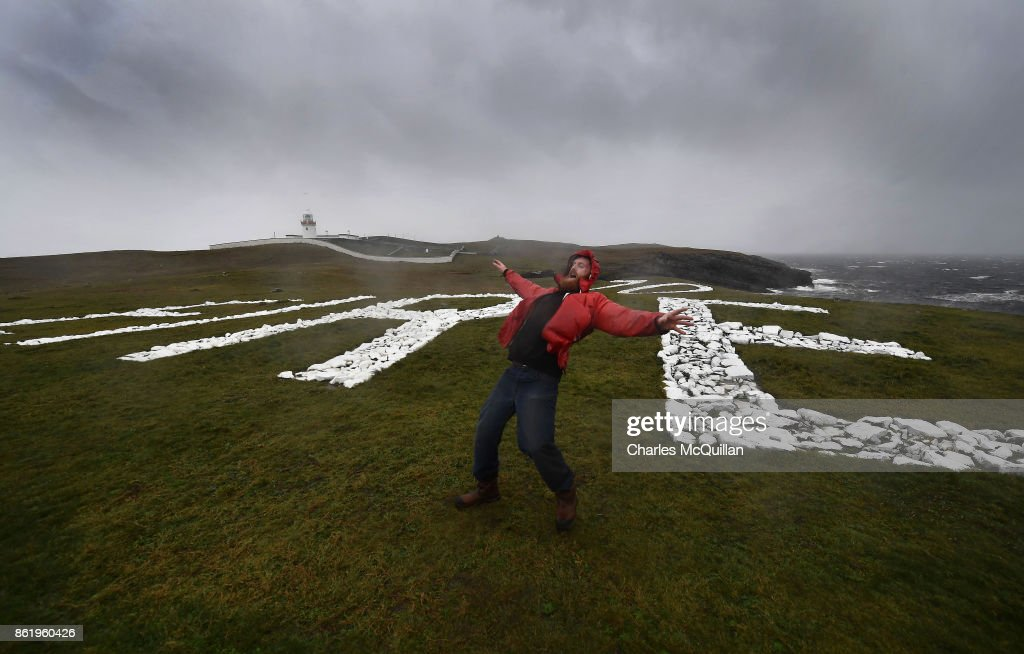 Al Mennie struggles against the wind at St. John's Point lighthouse where the word Eire is spelt out on white chalk for passing aeroplanes during Hurricane Ophelia on October 16, 2017 in Donegal, Ireland. The hurricane hit the north west coast of Ireland early this afternoon with winds in excess of 80mph. The Irish government have issued a red weather warning whilst amber weather warnings remain in place for Northern Ireland and parts of Wales.