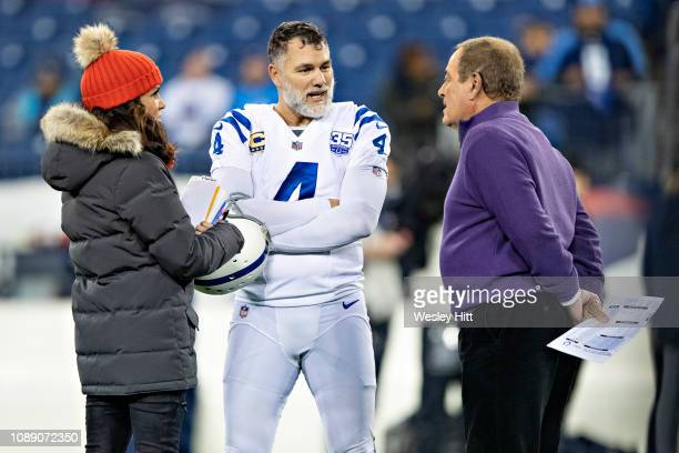 Al Michaels and Michele Tafoya and Adam Vinatieri of the Indianapolis Colts talk on the field before a a game against the Tennessee Titans at Nissan...