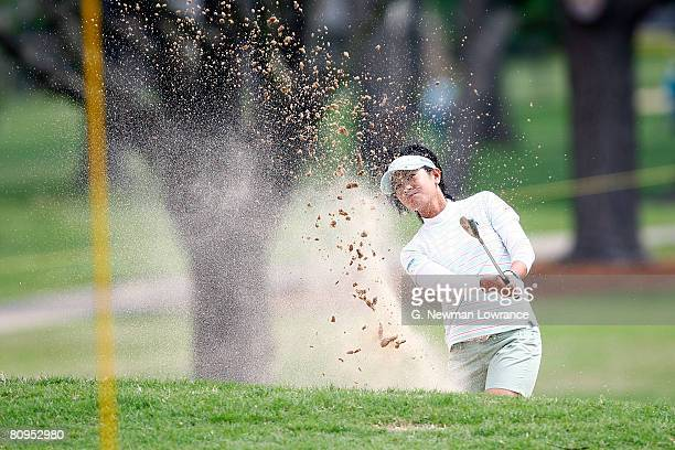 Al Miyazato of Japan hit out of a bunker on the 10th hole during the first round of the SemGroup Championship presented by John Q Hammons on May 1...