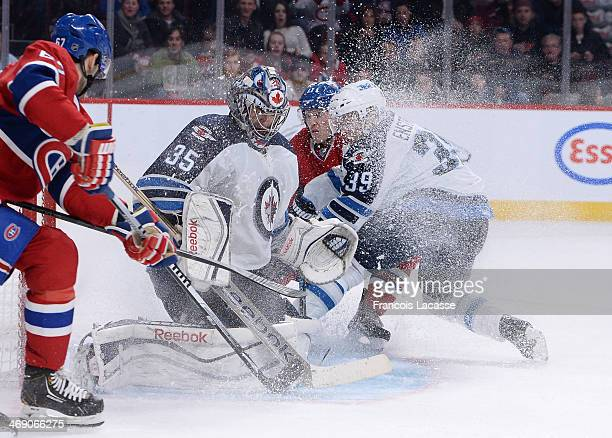 Al Montoya and Tobias Enstrom of the Winnipeg Jets defend the goal against Brendan Gallagher and Max Pacioretty of the Montreal Canadiens during the...