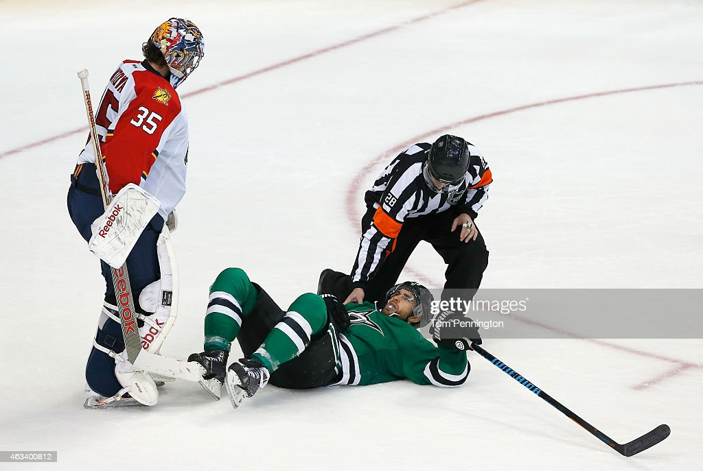 Al Montoya #35 of the Florida Panthers and referee Chris Lee #28 check on Patrick Eaves #18 of the Dallas Stars after Eaves was hit by a puck in the third period at American Airlines Center on February 13, 2015 in Dallas, Texas.