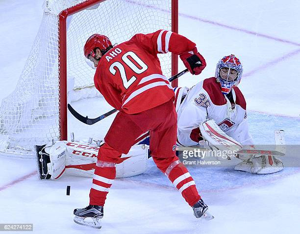 Al Montoya of the Montreal Canadiens blocks a shot by Sebastian Aho of the Carolina Hurricanes during the game at PNC Arena on November 18 2016 in...