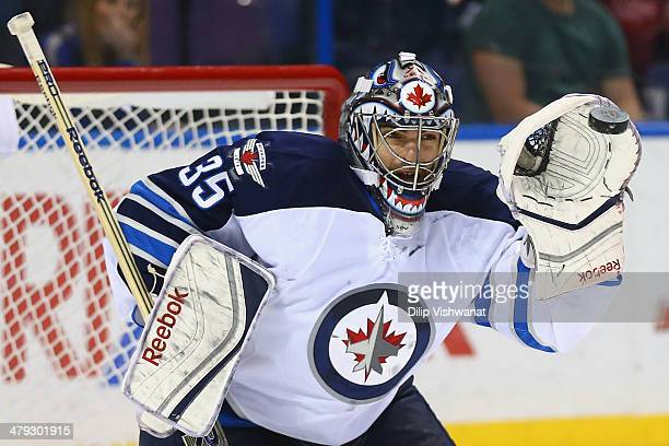 Al Montoya of the the Winnipeg Jets makes a save against the St Louis Blues at the Scottrade Center on March 17 2014 in St Louis Missouri