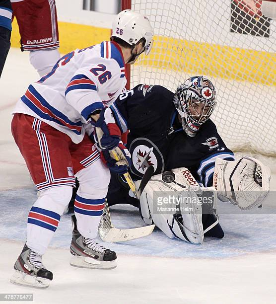 Al Montoya of the Winnipeg Jets blocks a shot on goal by Martin St Louis of the New York Rangers in third period action in an NHL game at the MTS...
