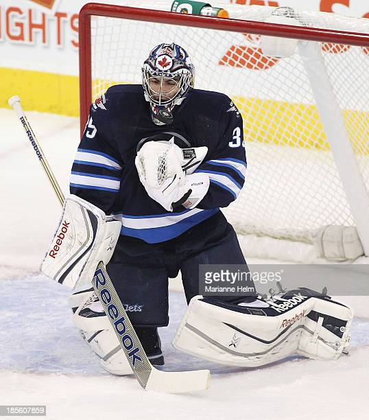 Al Montoya of the Winnipeg Jets blocks a shot on goal during firstperiod action in an NHL game against the New Jersey Devils at the MTS Centre on...