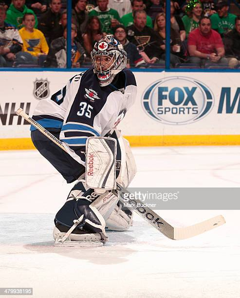 Al Montoya of the Winnipeg Jets defends the net against the St Louis Blues during an NHL game on March 17 2014 at Scottrade Center in St Louis...