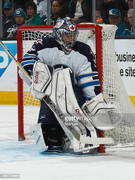 Al Montoya of the Winnipeg Jets gets in position for a shot against the San Jose Sharks during an NHL game on March 27 2014 at SAP Center in San Jose...