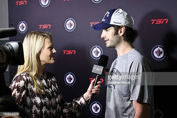 Al Montoya of the Winnipeg Jets gets interviewed by TSN reporter Sara Orlesky following a 54 overtime victory over the New York Islanders at the MTS...