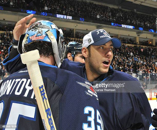 Al Montoya of the Winnipeg Jets is congratulated by teammate Ondrej Pavelec after backstopping the Jets to a 64 victory over the Minnesota Wild at...