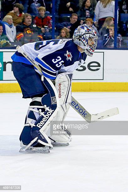 Al Montoya of the Winnipeg Jets lines up for a faceoff during the game against the Columbus Blue Jackets on December 16 2013 at Nationwide Arena in...