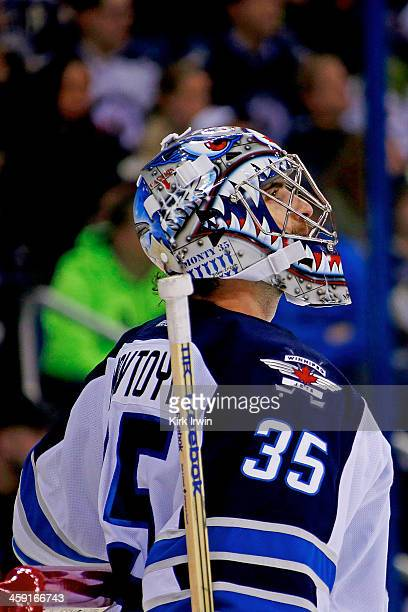 Al Montoya of the Winnipeg Jets looks up at the scoreboard during a stoppage in play in the game against the Columbus Blue Jackets on December 16...