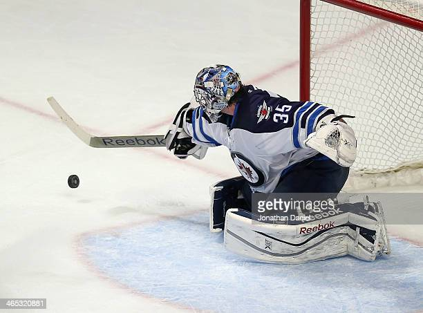 Al Montoya of the Winnipeg Jets makes a save against the Chicago Blackhawks at the United Center on January 26 2014 in Chicago Illinois The Jets...